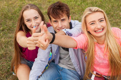 Great sunny day with best friends in park. Positive emotions. Royalty Free Stock Images