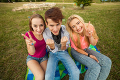 Great sunny day with best friends in park. Positive emotions. Stock Photos