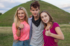 Great sunny day with best friends in park. Positive emotions. Royalty Free Stock Photography