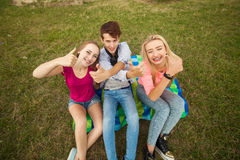 Great sunny day with best friends in park. Positive emotions. Stock Photo