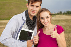 Great sunny day with in park. Positive emotions. Tablet pc. Royalty Free Stock Photography