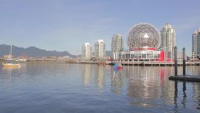 Great sunny day - Science world, mountains and skytrain stock video footage