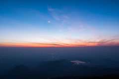 Great sunrise above the mountain valley and morning mist.  Stock Photo