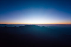 Great sunrise above the mountain valley and morning mist.  Royalty Free Stock Photo