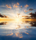 Great sunset above water Stock Photos