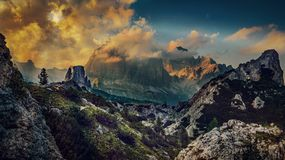 Great sunset view of the top Tofana di Rozes and Cinque Torri ra Stock Images