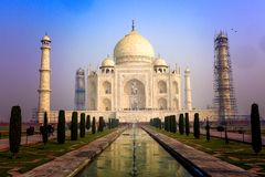 The great Taj Mahal. Dawn rises on the beautiful Taj Mahal in Agra, India. The most beautiful tomb of all Stock Photo