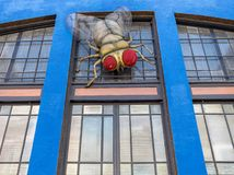 Great theater artwork. Huge fly on the wall, theater in Bisbee, Arizona royalty free stock photography