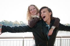 Great time - young couple together. Enjoying life - young couple together having fun outdoor Stock Images