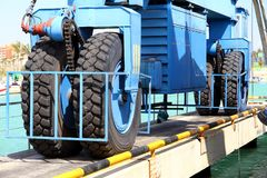 Details of big tires on shipyard travelift carrying a boat. Great tires used in a shipyard of Alicante city for carry a coastguard for made reparations royalty free stock images