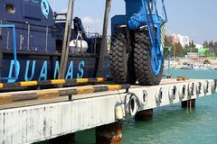 Details of big tires on shipyard travelift carrying a boat. Great tires used in a shipyard of Alicante city for carry a coastguard for made reparations royalty free stock photos