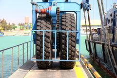 Details of big tires on shipyard travelift carrying a boat. Great tires used in a shipyard of Alicante city for carry a coastguard for made reparations stock images
