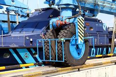 Details of big tires on shipyard travelift carrying a boat. Great tires used in a shipyard of Alicante city for carry a coastguard for made reparations stock photos