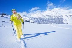 So great to be the first one to concur new terrain. One man walking with ski over the snow virgin land Stock Photos