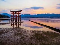 Great Torii of Itsukushima Shinto Shrine at sunset Royalty Free Stock Photo