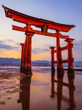 Great Torii of Itsukushima Shinto Shrine at sunset. View of the great floating torii of Itsukushima Shrine in Miyajima, Japan. UNESCO World Heritage Site Stock Image