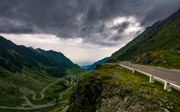 Great Transfagarasan rout in stormy summer weather. Great transport concept. gorgeous high altitude landscape on a rainy day. winding serpentine in Southern stock photography
