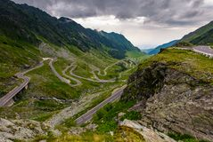Great Transfagarasan rout in stormy summer weather. Great transport concept. gorgeous high altitude landscape on a rainy day. winding serpentine in Southern royalty free stock image
