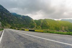 Great Transfagarasan rout in stormy summer weather. Great transport concept. gorgeous high altitude landscape on a rainy day. winding serpentine in Southern stock photo
