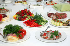 Great variety of food on table in restaurant Stock Image