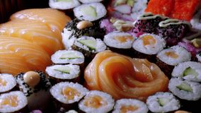 Great variety of sushi on a plate. Food photography stock video