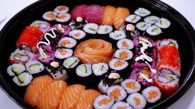 Great variety of Sushi on a plate. Food photography stock video footage