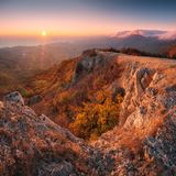 A great view of high mountains valley. With colorful clouds at sunset. Beautiful world. Crimea, Ukraine Royalty Free Stock Image