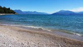 Great view of Lake Garda from Sirmione beach Lido delle Bionde, Italy Royalty Free Stock Image