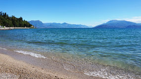 Great view of Lake Garda from Sirmione beach Lido delle Bionde, Italy Royalty Free Stock Photos