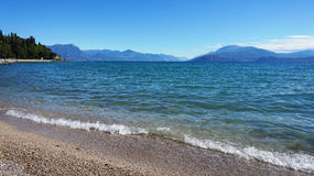 Great view of Lake Garda from Sirmione beach Lido delle Bionde, Italy Royalty Free Stock Images