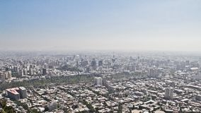 Great view over the city Santiago de Chile. Mountain range in th. E background. Some light and fog Royalty Free Stock Image