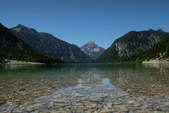 A great view over a lake to the mountains. you can see such views during traveling in bavaria germany royalty free stock images