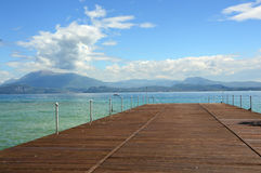 Great view of pier on Lake Garda from Sirmione beach, Italy stock photography