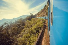 Great view with speed going train over the green hills of Sri Lanka Royalty Free Stock Images