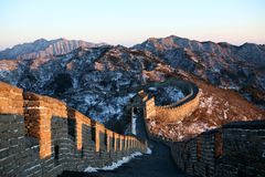 Great Wall. And mountains covered with snow Royalty Free Stock Images