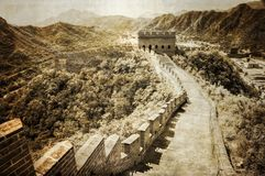 Great Wall of China. Vintage sepia view of Great Wall of China with mountain range in background Royalty Free Stock Photo