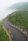 Great Wall China. Guard tower on the Great wall on an overcast and foggy day in Beijing, China Stock Photography