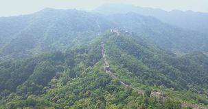 Great Wall of China, aerial footage, drone footage, Beijing. Great Wall of China close to the Beijing Airport. Truly marvelous view with plenty of trees. This is stock video