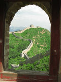 Great Wall of China through Archway. A view of the Great Wall of China through a brick arch royalty free stock images