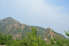 Great Wall of China in the Distance. The Great Wall of China extends into the distance with stones and trees Stock Photo