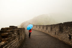 Blue Umbrella. Bad weather great wall of china Royalty Free Stock Image
