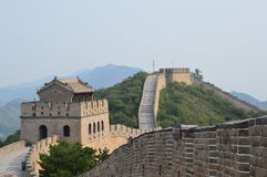 Great Wall of China Guard Tower. Great Wall guard tower with mountains and trees Royalty Free Stock Photo
