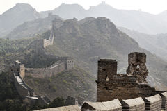Great Wall of China. Scenic view of Great Wall of China receding over mountains into distance, viewed in hazy sunlight Stock Images