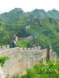 Great Wall of China. A section of 'wild wall' along the Great Wall of China with a large section in the foreground and stretching into the distance (Portrait Stock Image
