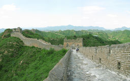 Great Wall of China. A section of 'wild wall' along the Great Wall of China with a large section of the walkway in the foreground (slight panoramic Stock Photos