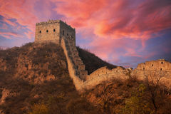 Great wall of China. At sunset with dramatic clouds stock images