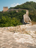 Great Wall of China with a watchtower on a background of mountains Royalty Free Stock Photo