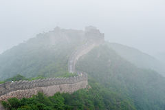 The Great Wall in Fog. Tourists walk on the Great Wall of China Royalty Free Stock Images