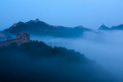 The Great Wall in the morning mist. Jinshanling Great Wall of China in the morning fog, towering, majestic, sacred stock photos