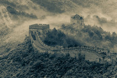 The Great Wall. It was in Jun 2013, the early summer of Beijing City. We climbed up the hills in the early morning and saw fog around the Great wall Royalty Free Stock Photo